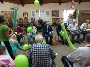 Aspen Senior Center Activity - Hit the balloon with the foam pool nootle