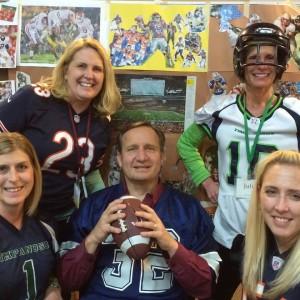 5 staff members dressed in football gear