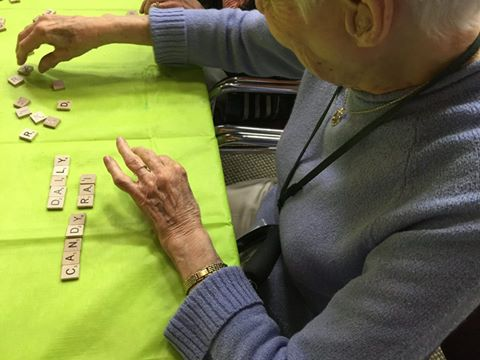 Senior playing scrabble