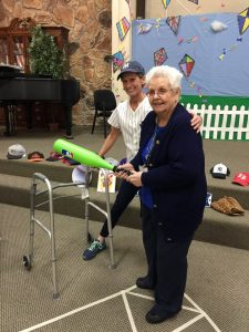 Julie and client playing baseball at Aspen Senior Day Center
