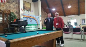 Bill and Gary enjoy a game of pool at Aspen Senior Day Center in Provo, Utah.
